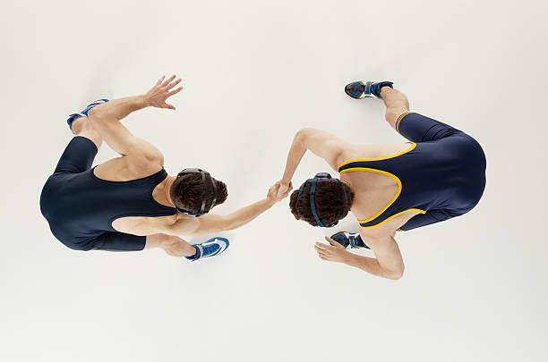 Overhead view of two men wrestling stock photo