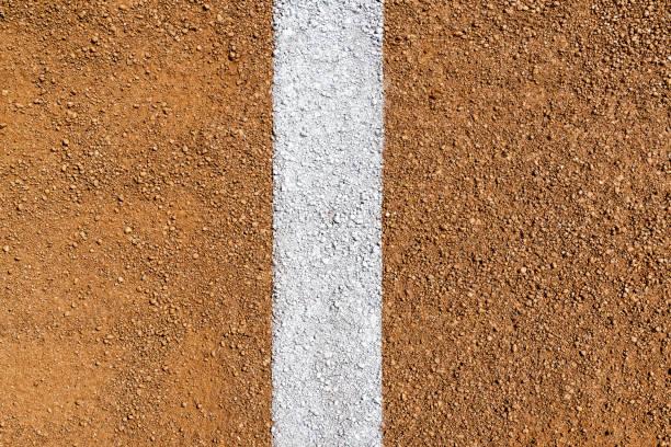 Overhead view of white Foul Line on dirt of baseball diamond stock photo