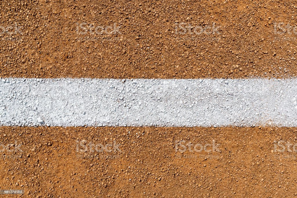 Overhead view of white Foul Line on dirt of baseball diamond stock photo