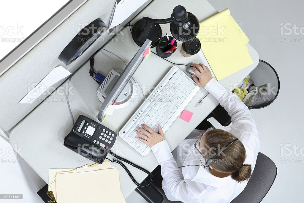 Overhead view of woman at office desk royalty-free stock photo