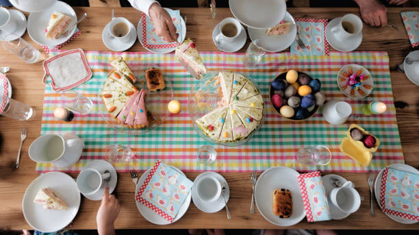 overhead view on easter table with family around stock photo