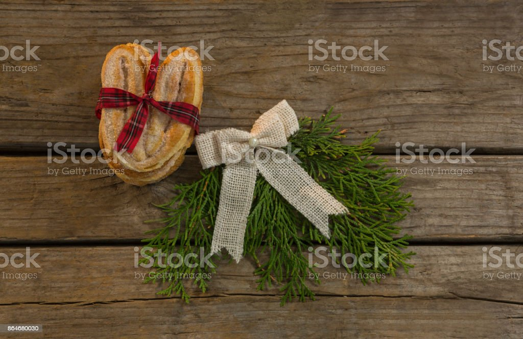 Overhead view sweet food with tied bow and pine needles on table stock photo