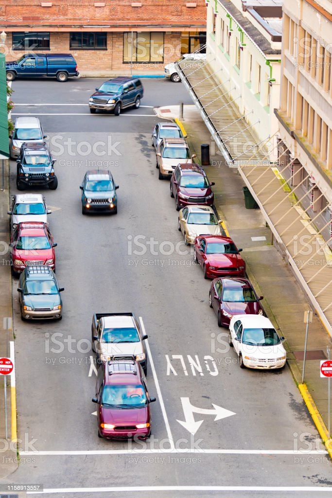 Overhead/drone/aerial view of cars stopped behind white line at stop...