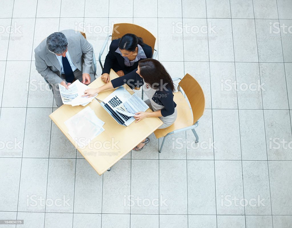 Overheard view of business team meeting royalty-free stock photo