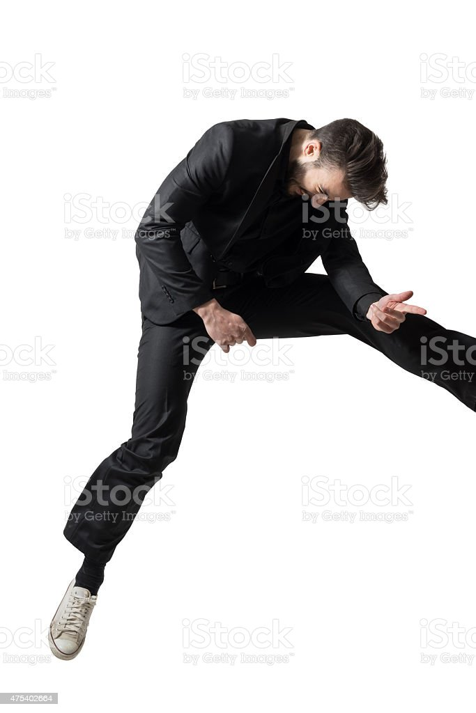 Overjoyed businessman jumping out of the frame playing air guitar stock photo