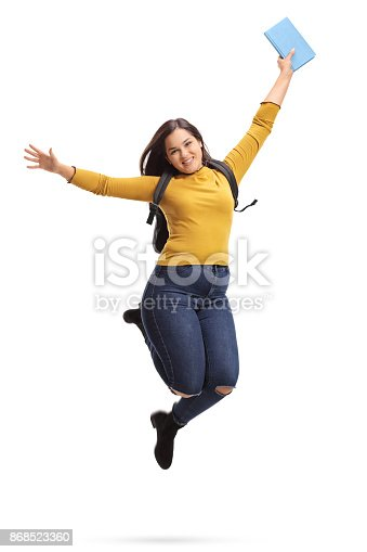 istock Overjoyed female student jumping and gesturing happiness 868523360