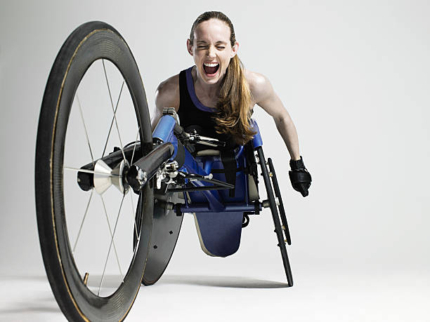 overjoyed female wheelchair athlete - wheelchair sports stock photos and pictures