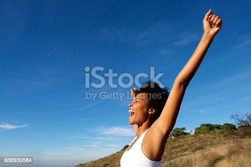 508455188 istock photo Overjoyed fit woman standing outdoors 638930584