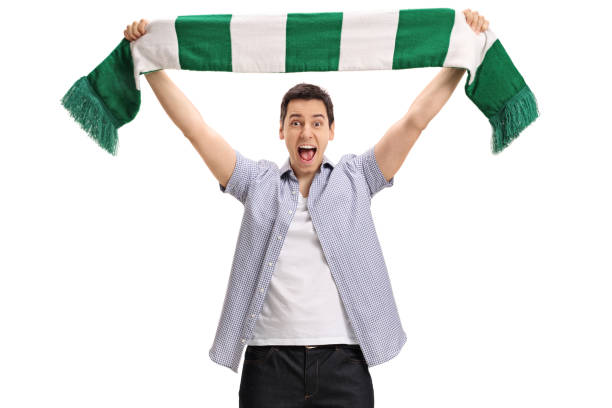 overjoyed football fan holding a scarf and cheering - soccer supporter portrait imagens e fotografias de stock