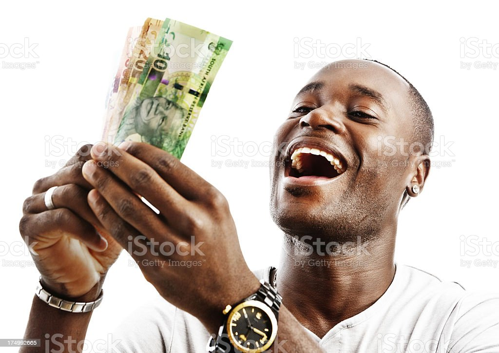 Overjoyed man holds up South African banknotes. Payday perhaps stock photo