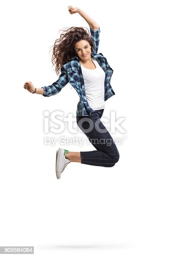 istock Overjoyed teen girl jumping and gesturing happiness 905584084