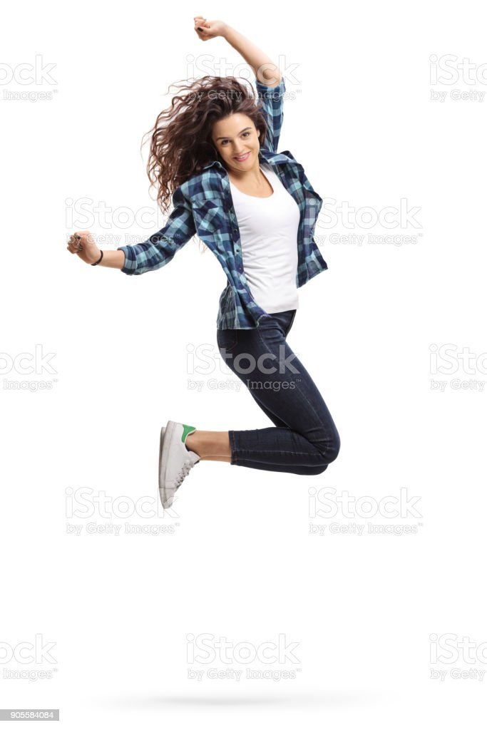 Overjoyed teen girl jumping and gesturing happiness stock photo
