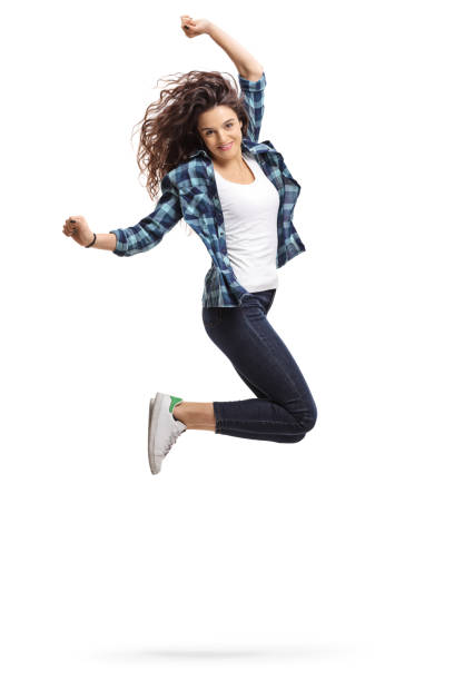 overjoyed teen girl jumping and gesturing happiness - mid air stock pictures, royalty-free photos & images