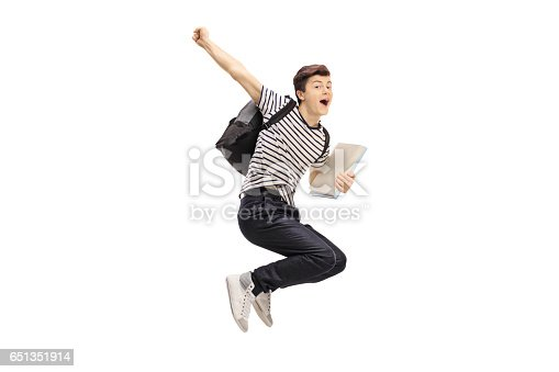 istock Overjoyed teenage student jumping and gesturing happiness 651351914