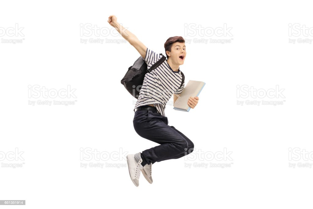 Overjoyed teenage student jumping and gesturing happiness stock photo