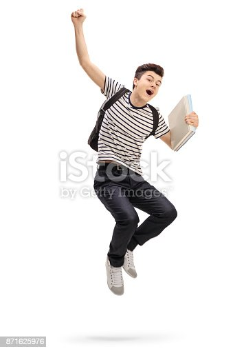 istock Overjoyed teenage student jumping and gesturing happiness 871625976