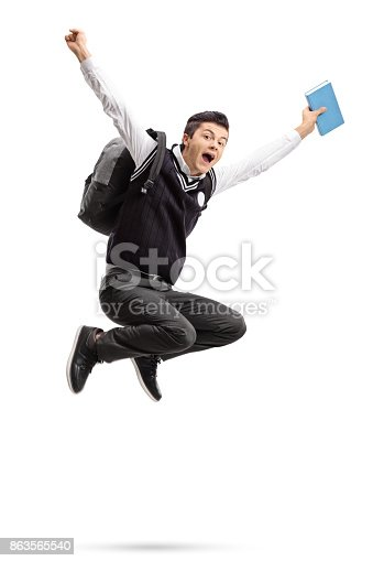 istock Overjoyed teenage student with a backpack and a book jumping 863565540