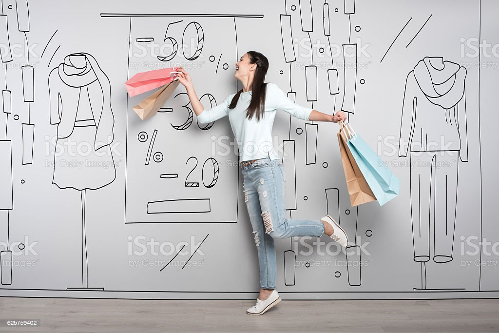 Overjoyed woman smiling after shopping stock photo