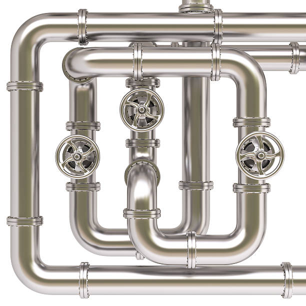 Overlapping silver pipes with valves stock photo