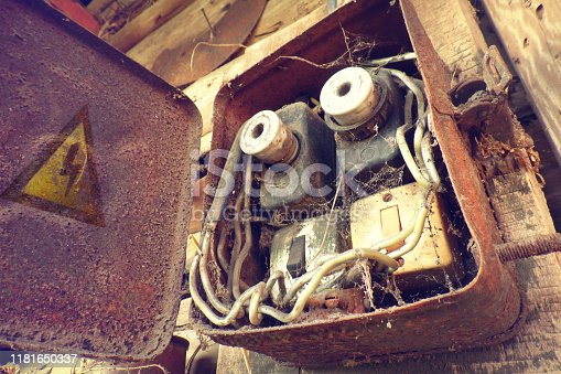 Overloaded electrical circuit causing electrical short and fire. Old electric power supply boxes. Overloaded electrical circuit causing fuse to break. Break The Rules