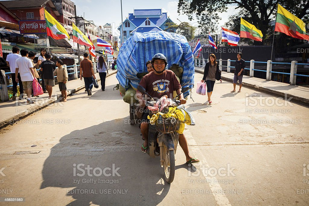 Overloaded motorbike, Mae Sai, Thailand royalty-free stock photo