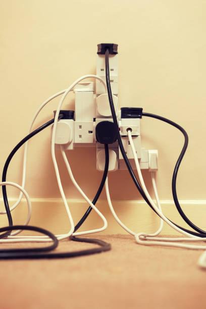 Overloaded multi extension plug stock photo