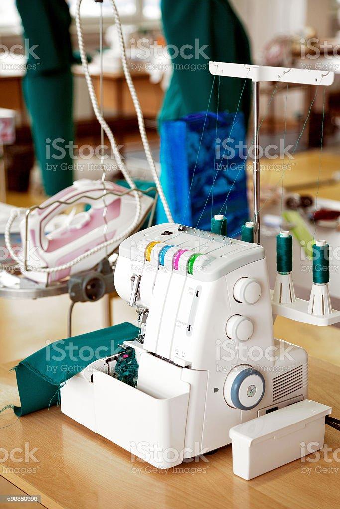 Overlock sewing machine in tailor office. Fashion designer equipment serger stock photo