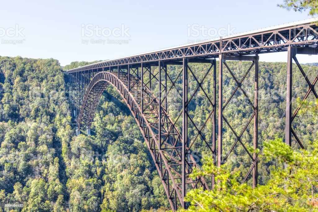Overlook of West Virginia green mountains in spring, summer or autumn fall at New River Gorge Bridge with closeup of metal structure stock photo