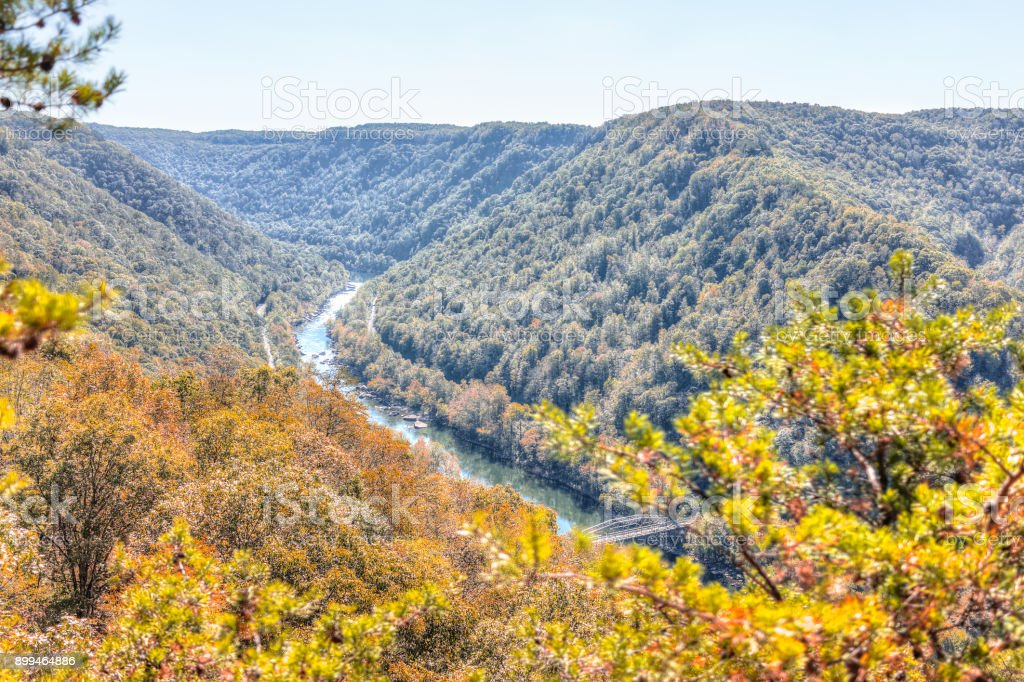 Overlook of West Virginia green, orange mountains in autumn fall at New River Gorge Bridge stock photo