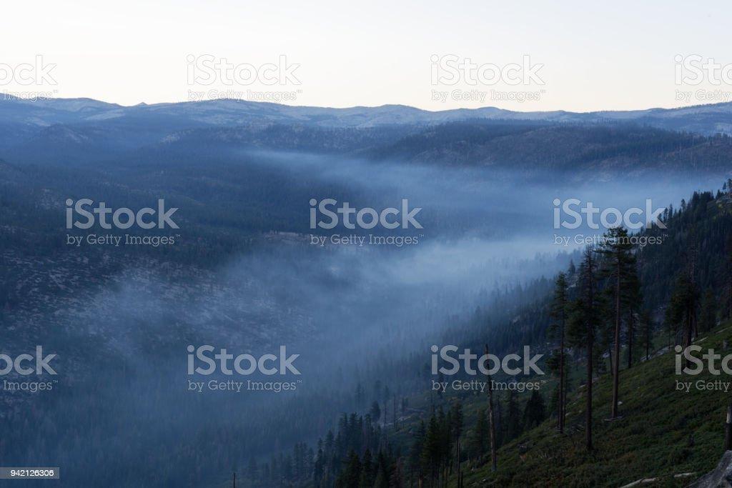 Overlooking a smokey mountain valley stock photo