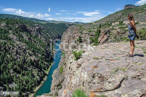 Woman looking into the Gunnison River, Colorado.