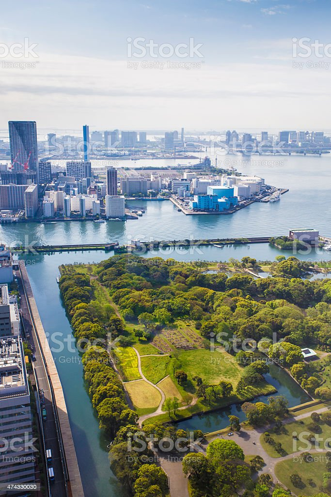 overlooking Hama Rikyu park Shiodome district in the background stock photo