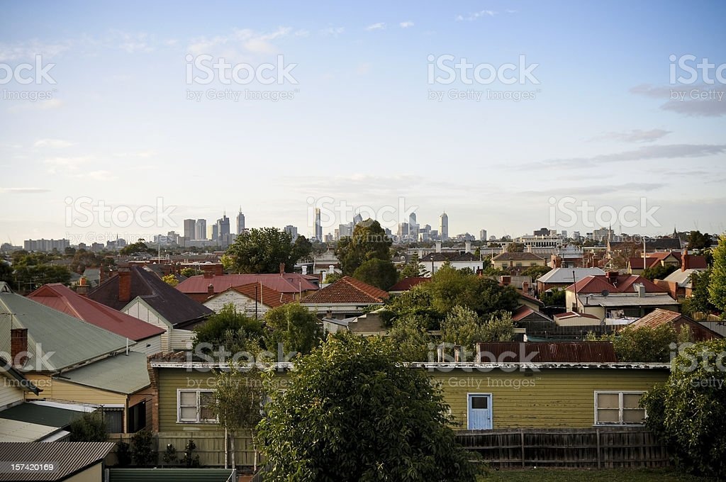 Overlooking suburban roofs towards a city skyline royalty-free stock photo