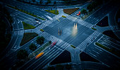 istock Overlooking the city's ten road traffic intersection markings and driving vehicles 1271649572