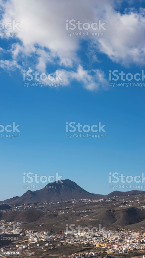 Overlooking the idyllic villages on the hills of Valle San Lorenzo, with Roque del Conde mountain in the background, Tenerife, Canary Islands. stock photo