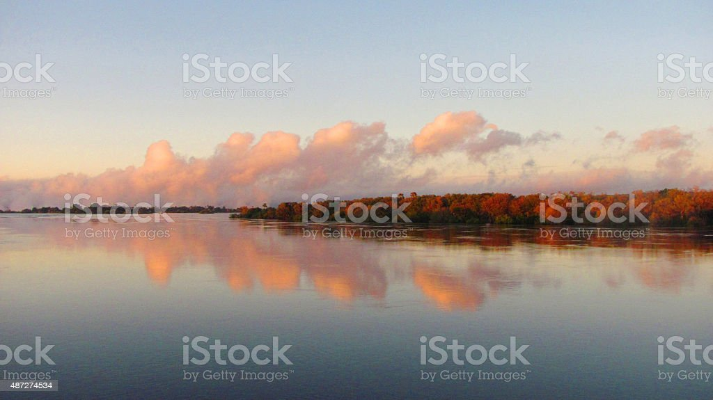 Overlooking the tranquil Zambezi river during sunrise stock photo