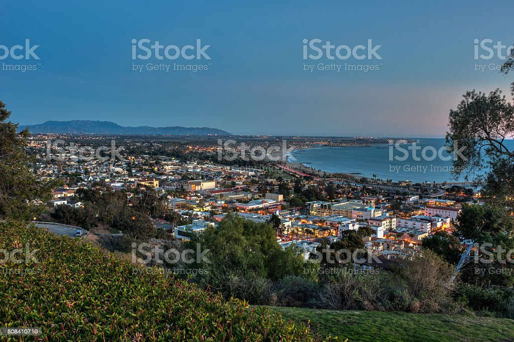 Overlooking town nestled against ocean shore. stock photo
