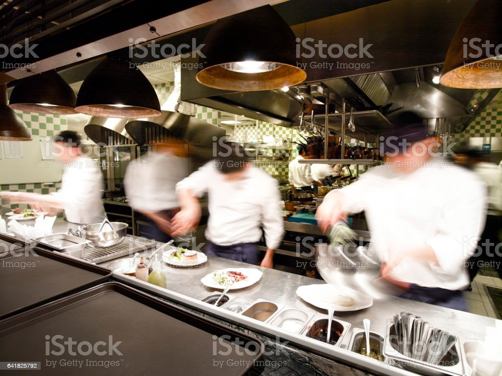 Overly busy restaurant kitchen stock photo
