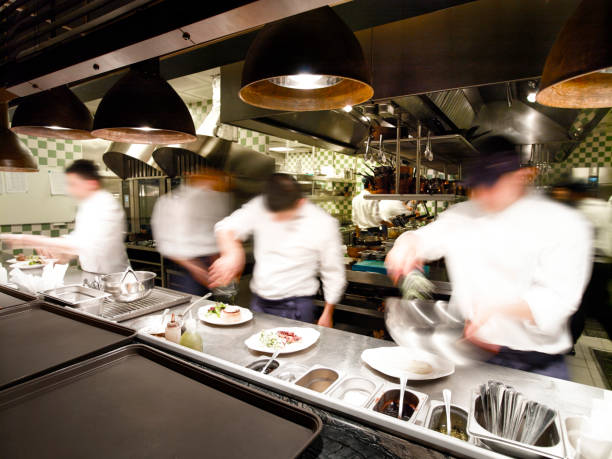 overly busy restaurant kitchen - busy stock photos and pictures