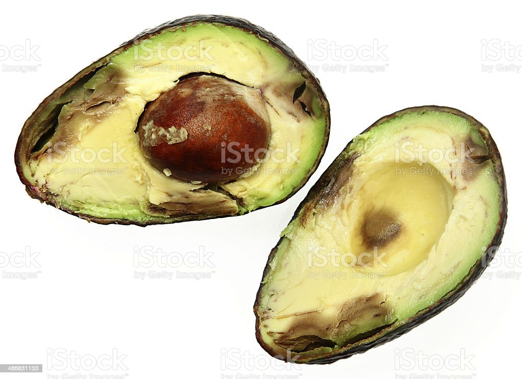 Overly Ripe Avocado Sliced with Seed Over White stock photo