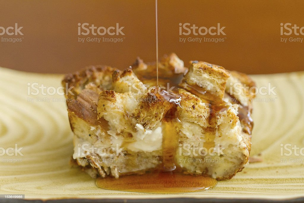overnight french toast with a syrup drizzle puddle stock photo