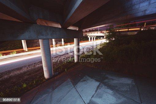 Traffic passes beneath highway overpasses.