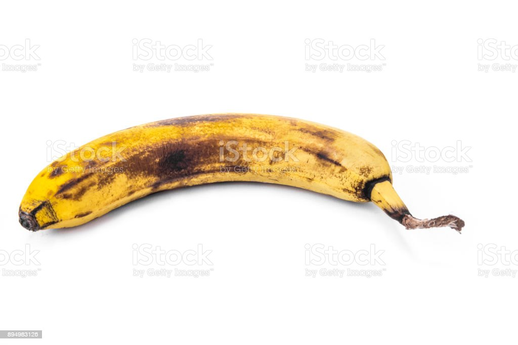 Overripe banana on the white background stock photo