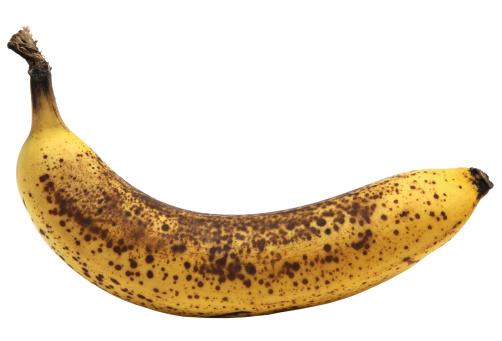 Overripe banana isolated on white