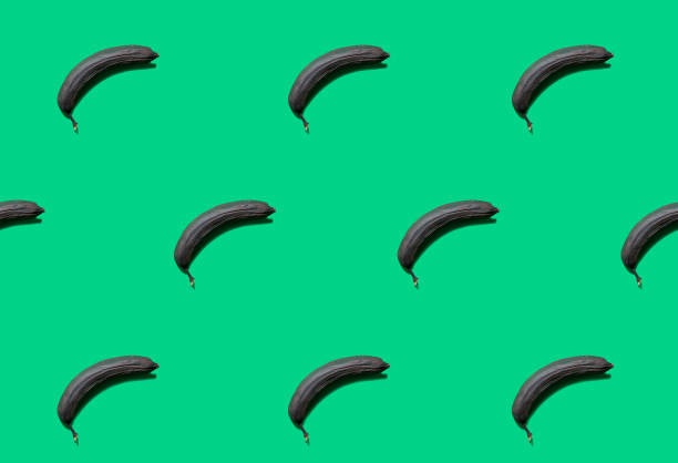 Overripe bananas isolated on green background. Overripe bananas isolated on green background. addle stock pictures, royalty-free photos & images