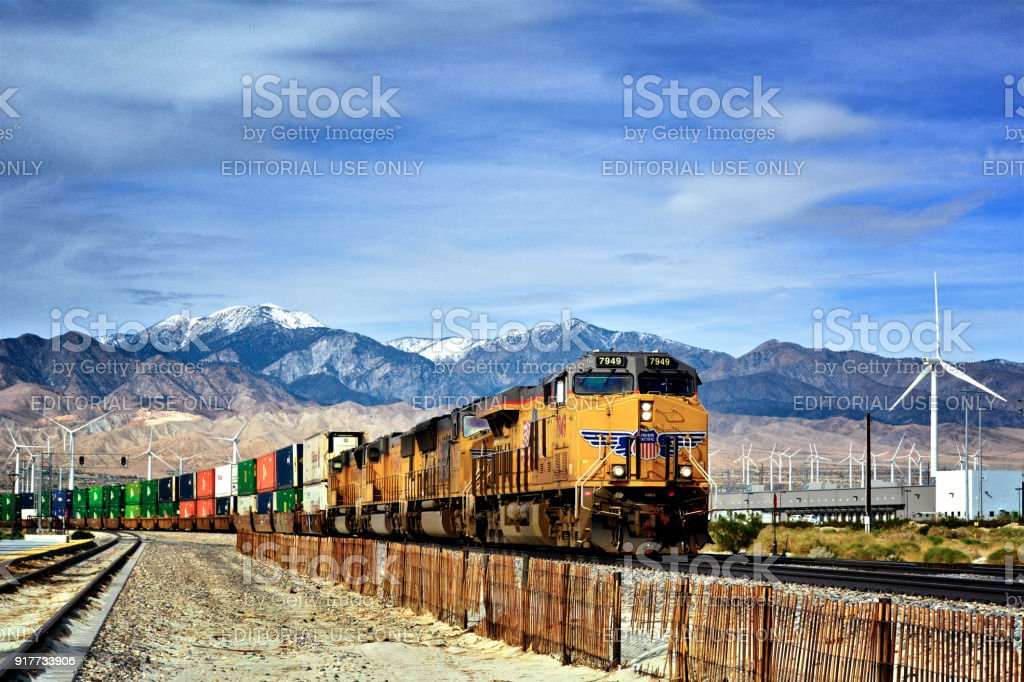 Overseas Cargo Containers on Freight train - Palm Springs, California, USA stock photo