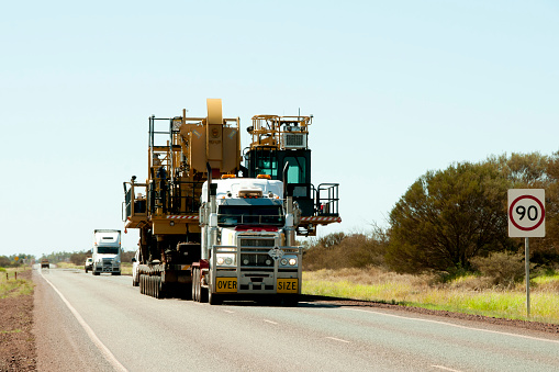 Oversize Heavy Machinery Transport Stock Photo - Download Image Now