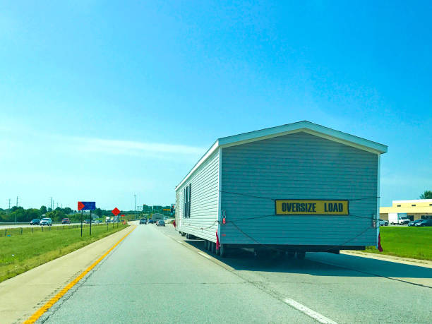 Oversized Load Tiny Home on Highway oversized load manufactured housing stock pictures, royalty-free photos & images