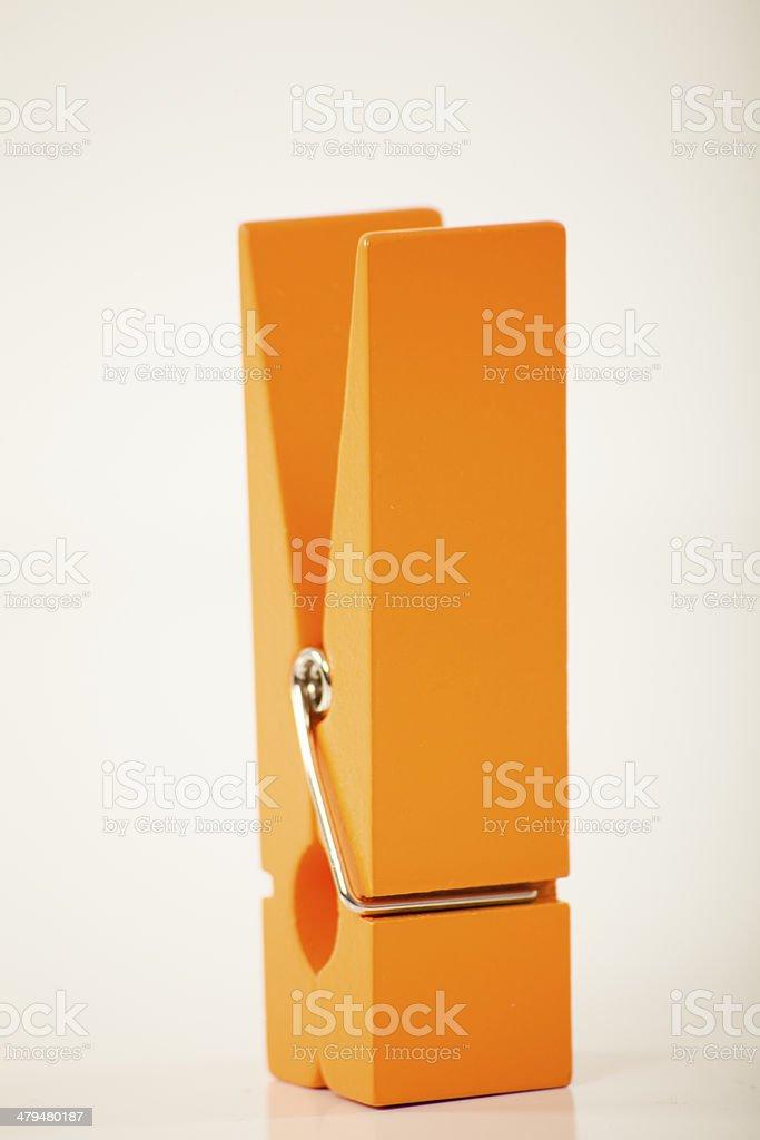 oversized orange clothes pin stock photo