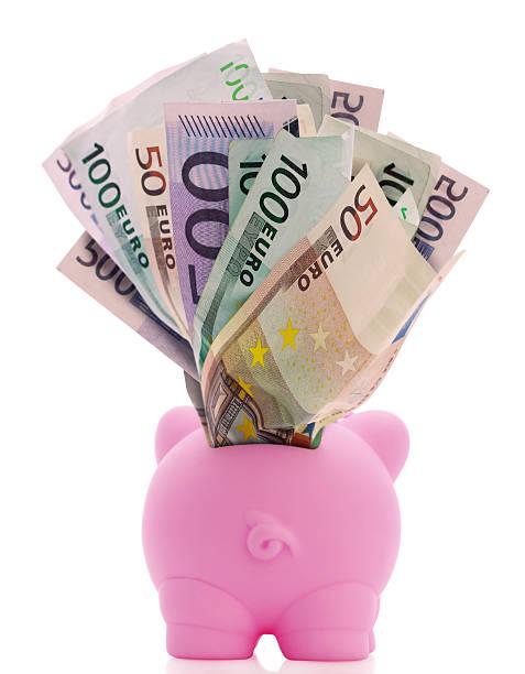 Overstuffed Piggy Bank stock photo